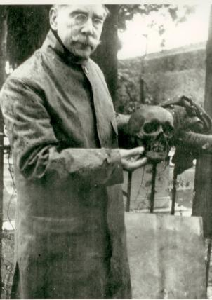 A Smithsonian official holds James Smithson's skull, when Smithson's body was exhumed in Genoa, Italy, and brought to the U.S. to be placed in a crypt in the Smithsonian castle in 1904-5.