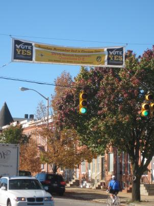 Banners hang over streets in Baltimore urging voters to cast ballots for eight bond measures.