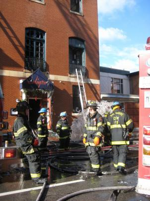 Crews finish snuffing out hot spots at a fire that gutted an historic building that housed three restaurants and numerous businesses in the city's cultural district.