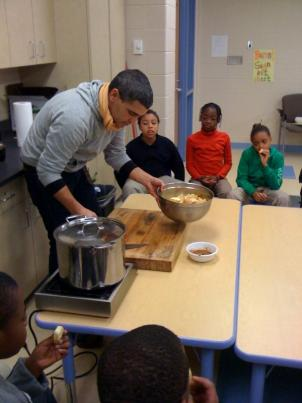 Farmer John Cochran teaches students about the origins of apple sauce in the kitchen classroom at Walker Jones Education Center in D.C.