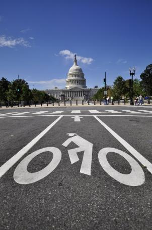 D.C. Council Member Phil Mendelson says he will call a hearing for better traffic law enforcement, as the number of bicyclists sharing the road grows.