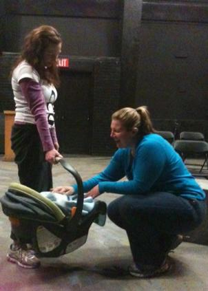 Jackie and Harriet look at baby Daniel during a rehearsal for She Said/She Said.
