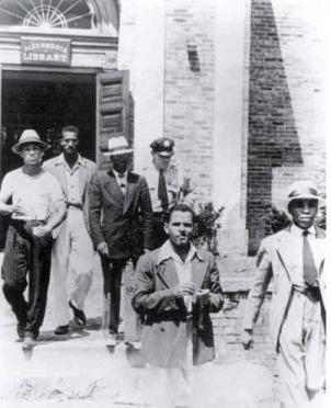 These men were escorted out of Barrett Library in Alexandria, Virginia during a 1939 civil rights sit-in.