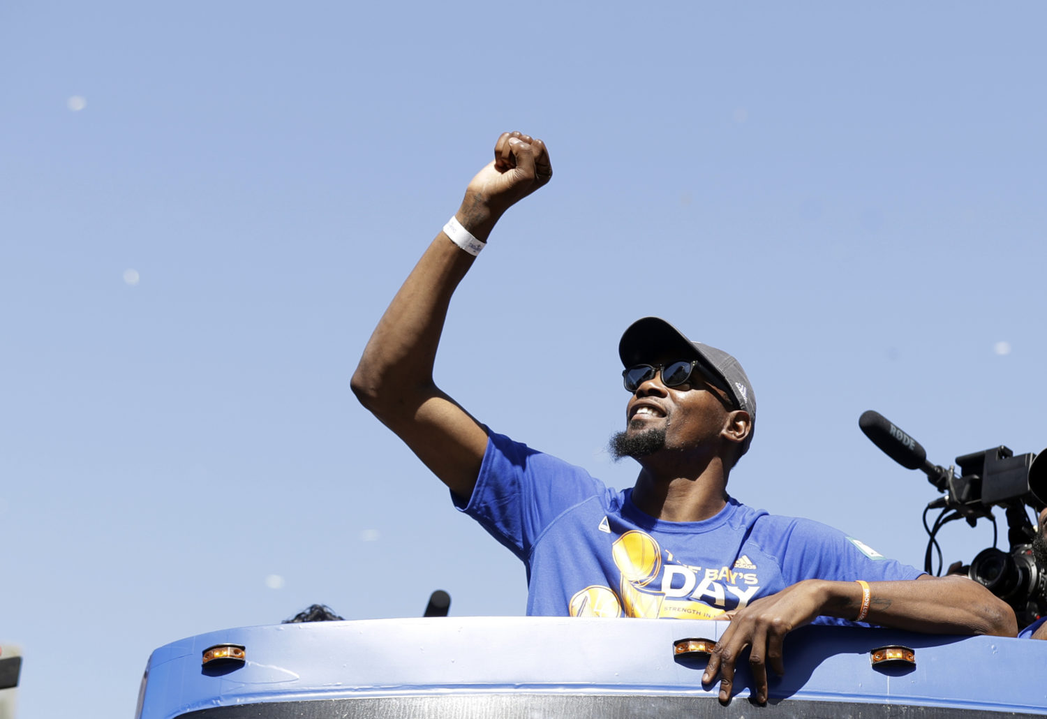 brand new dfaad 4aff6 Golden State Warriors star Kevin Durant celebrates during a parade and  rally in Oakland, California after winning the NBA basketball championship.