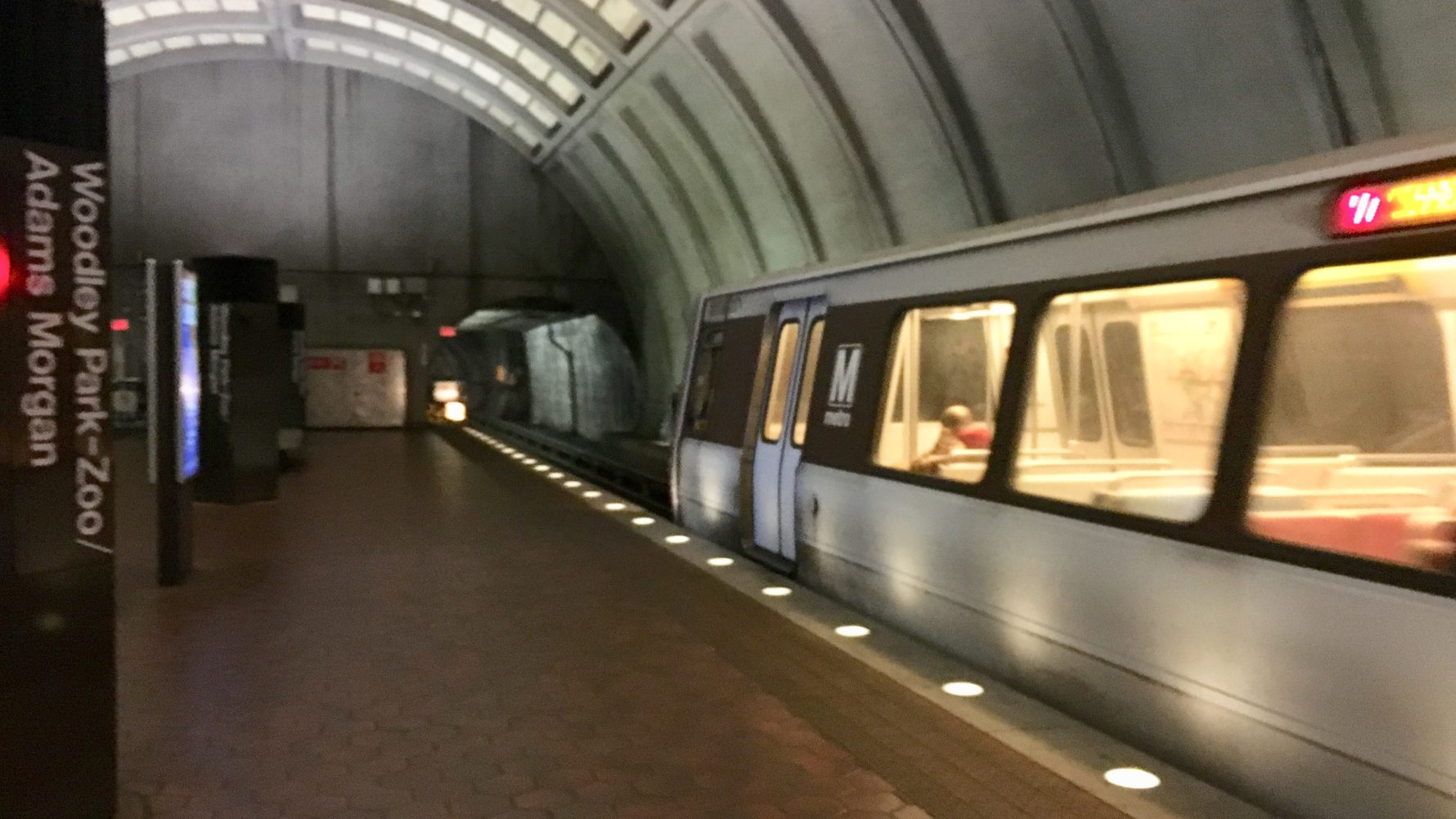 A Red Line train pulls into a quiet Woodley Park station during midday.  Officials in D.C., Maryland and Virginia are expected to fall short of  recommending ...
