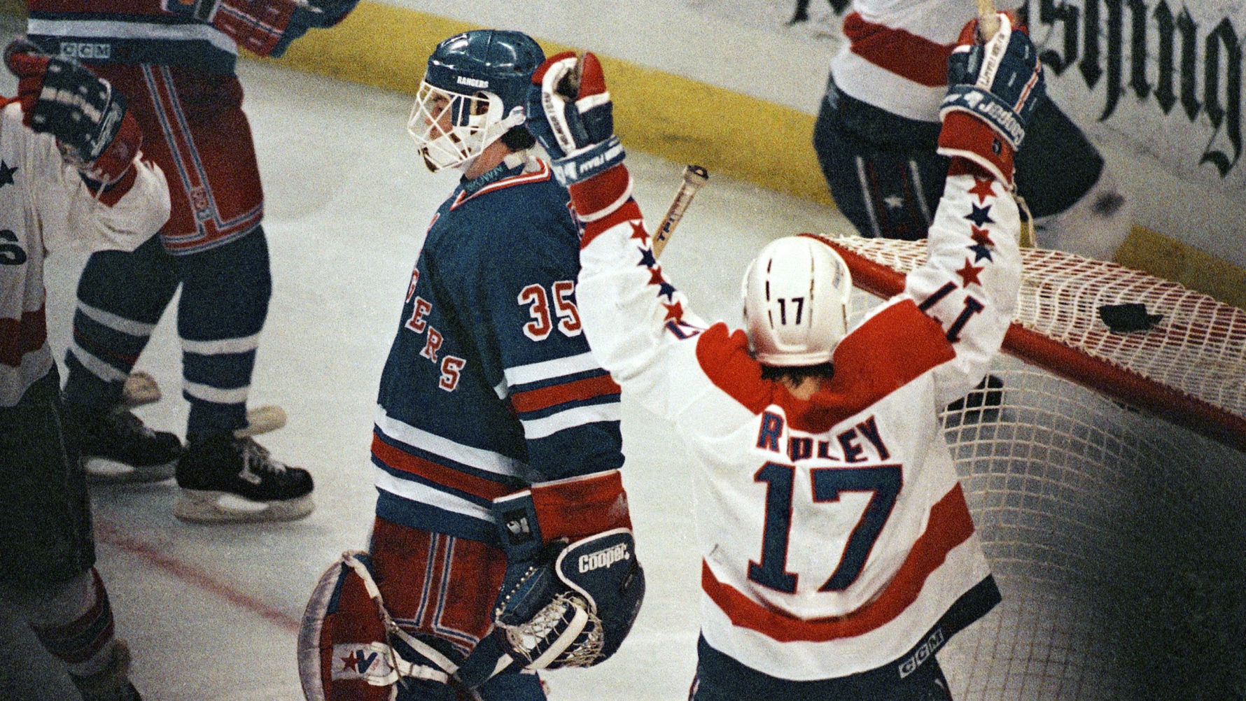 Washington Capitals center Mike Ridley celebrates his teammate Rod  Langway s game-winning overtime goal against the New York Rangers in 1990. 4c1aba01822