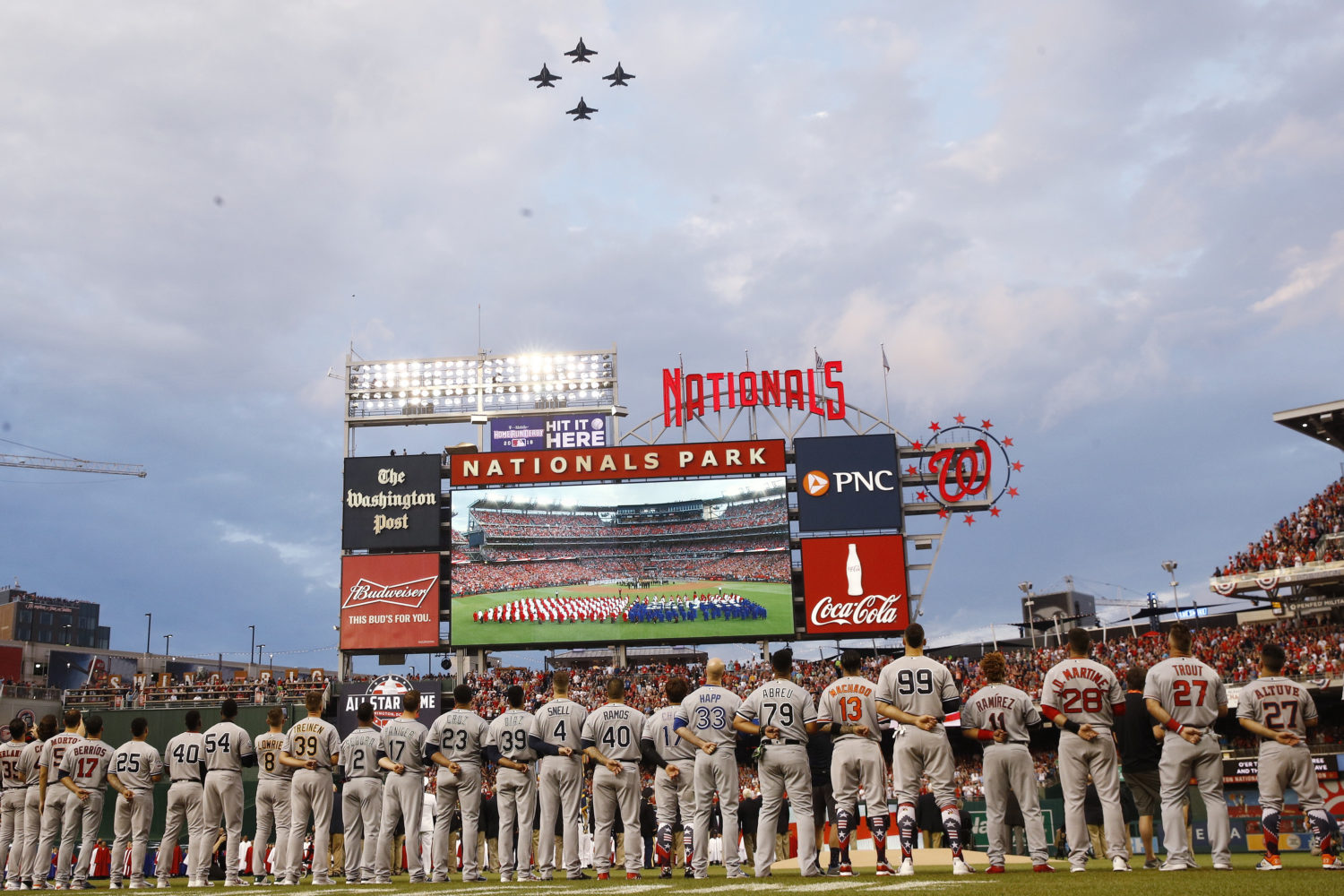 5bc8ee64 American League players watch a military flyover before Major League  Baseball's All-Star Game at Nationals Park.