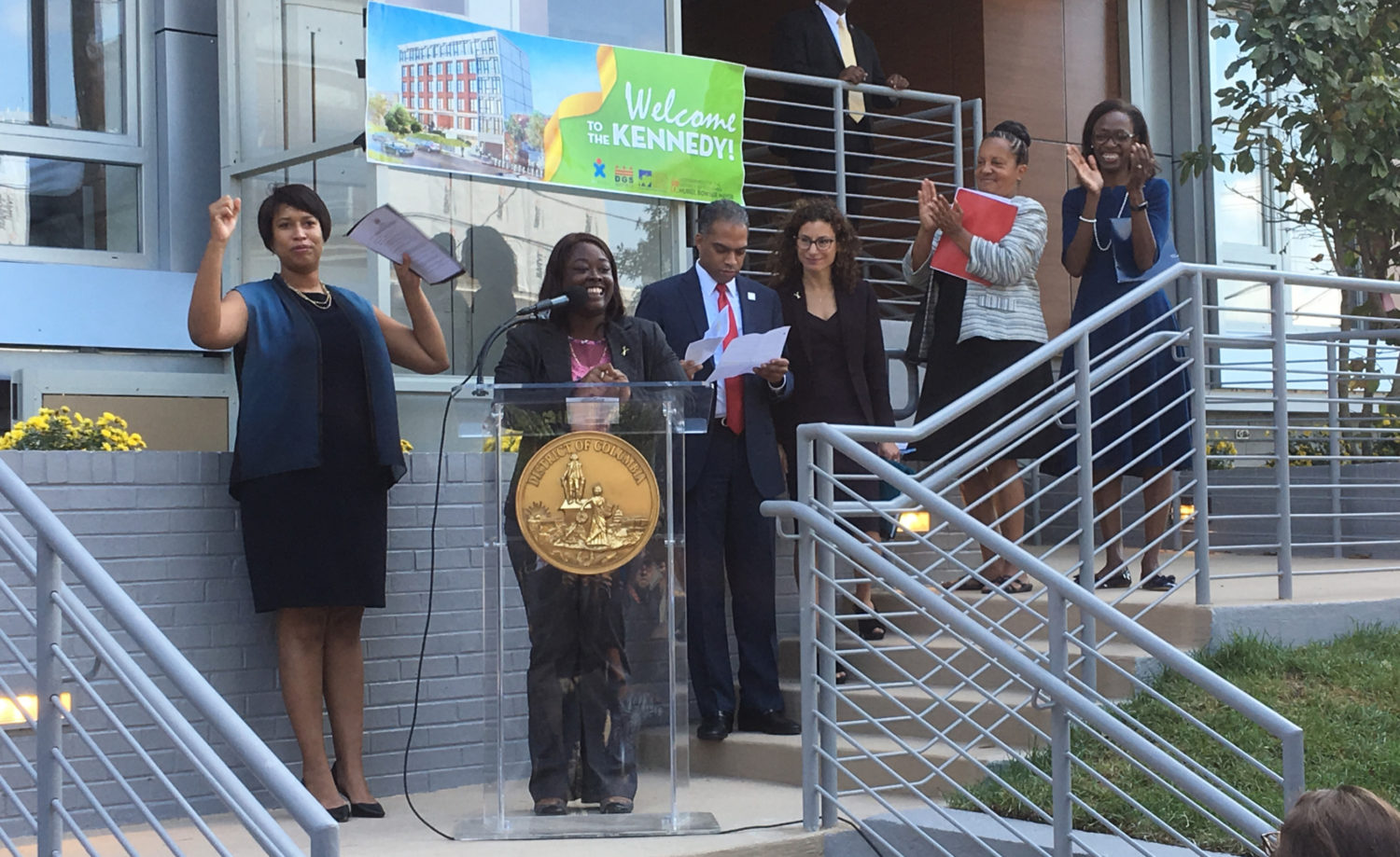Mayor Muriel Bowser standing alongside Markita Abbott, who was homeless and lived at D.C. General, at the ribbon-cutting for The Kennedy, a new 45-unit ...