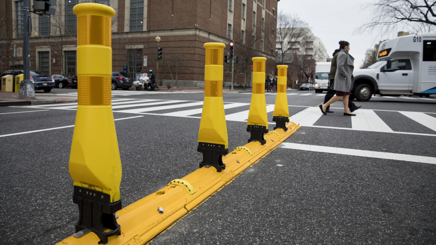 Картинки по запросу yellow pylons in the center of streets to slow down cars